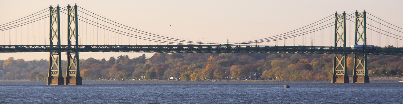 Banner photo showing the Interstate 74 suspension bridge over the Mississippi River in the Quad Cities that connects Illinois to Bettendorf, Iowa